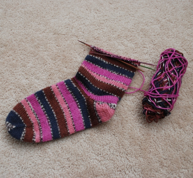 One sock, almost done. But I don't remember the pattern I based this off of - and I'm sure my gauge has changed.