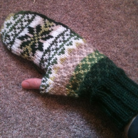 I don't know why I haven't finished this mitten pattern - it's pretty nice, just a little long below the thumb. So I still have to knit this thumb, plus the 2nd mitten, and I betcha my gauge has changed over the years this has been sitting!